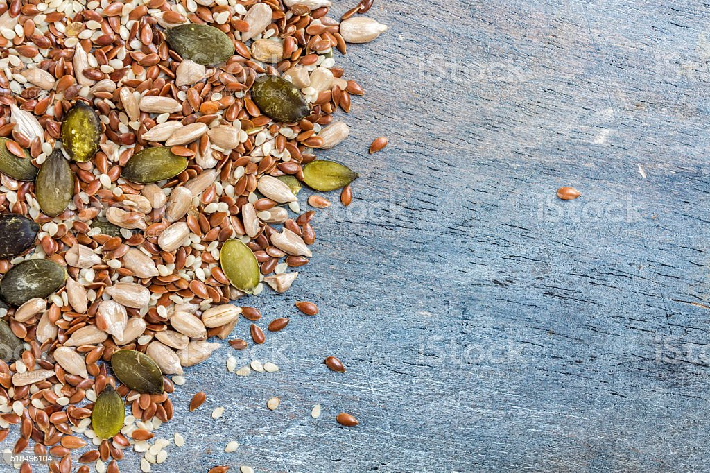 Mixture of seeds with space for copy stock photo