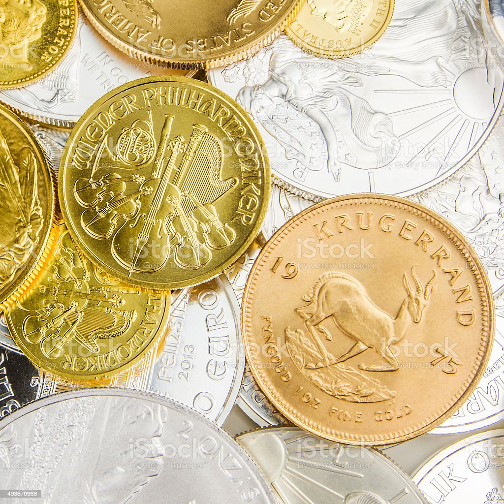 mixture of silver and golden coins stock photo