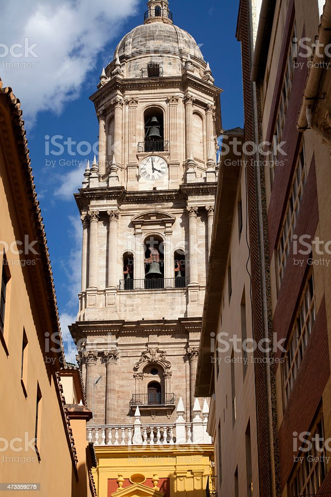M?laga cathedral tower from a narrow street below. stock photo