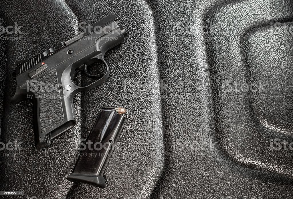 9 mm pistol with magazine and ammunition stock photo