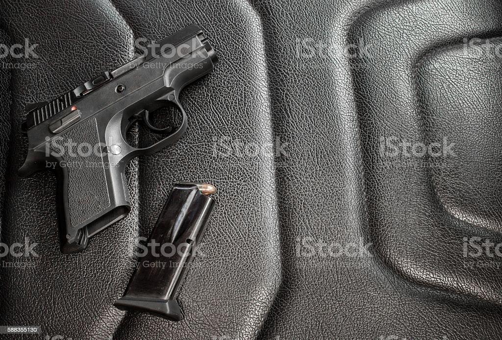 9 mm pistol with magazine and ammunition stock photo