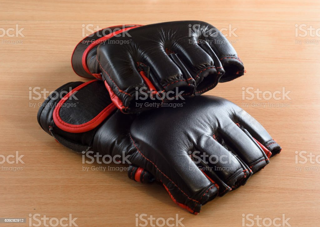 mma gloves on wooden background stock photo