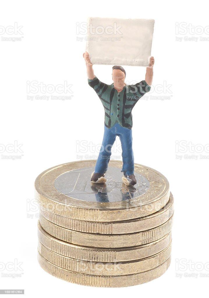 Männchen mit Plakat auf Euromünzen stock photo