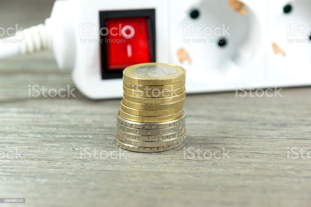 Münzen und Steckerleiste stock photo