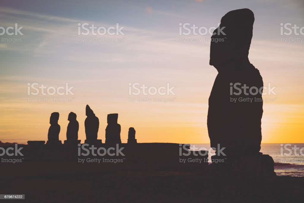 Moai Ahu Tahai and Ahu Vai Ure Silhouettes at Sunset Rapa Nui Hanga Roa stock photo