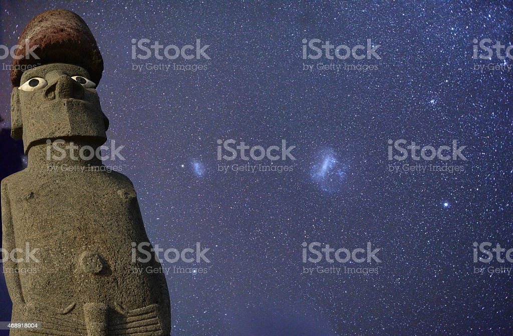 Moai statue under starry Easter Island sky, Chile. stock photo