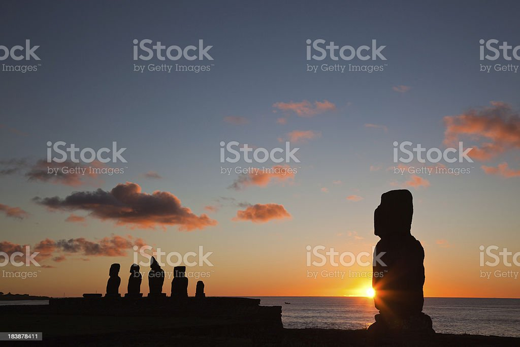 Moais at sunset, Easter Island, Chile stock photo