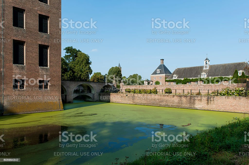 Moat and part of the main building of Amerongen castle stock photo