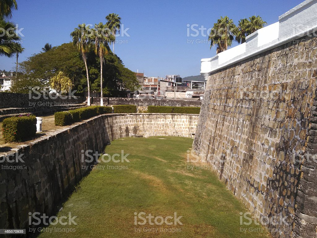 Moat and stone walls of fort san diego acapulco Mexico stock photo