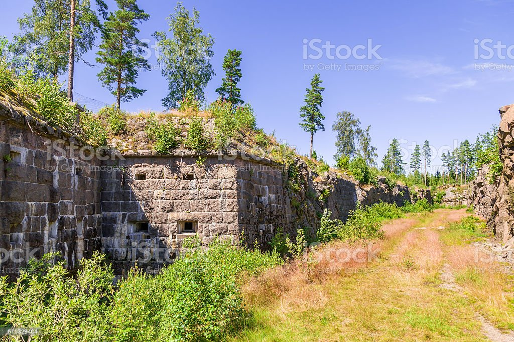 Moat into an old fortress embedded in solid rock stock photo