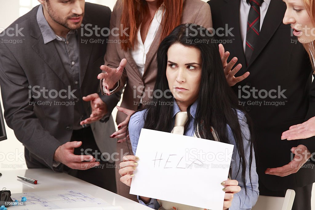 Mobbing with help me sign royalty-free stock photo