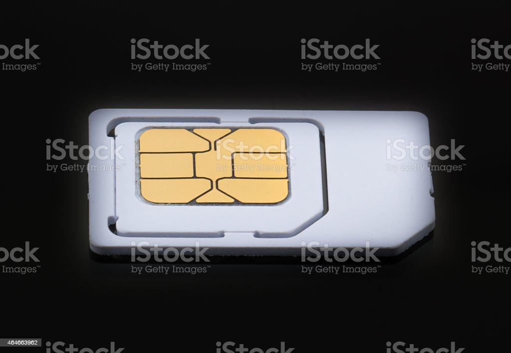 Mobil sim card on black floor background stock photo