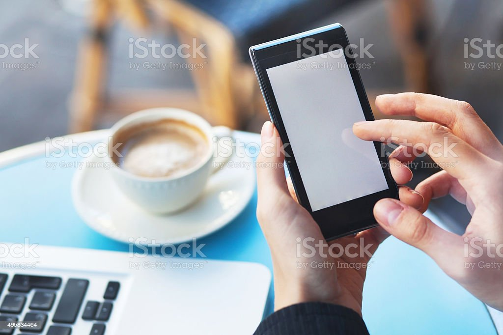mobile and coffee in cafe stock photo