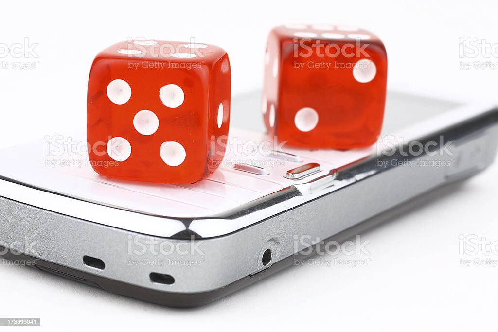 Mobile and dice royalty-free stock photo
