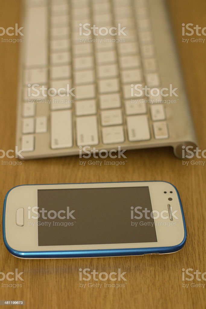 Mobile and keyboard royalty-free stock photo