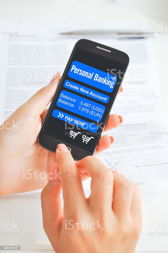 Mobile banking app on smartphone stock photo