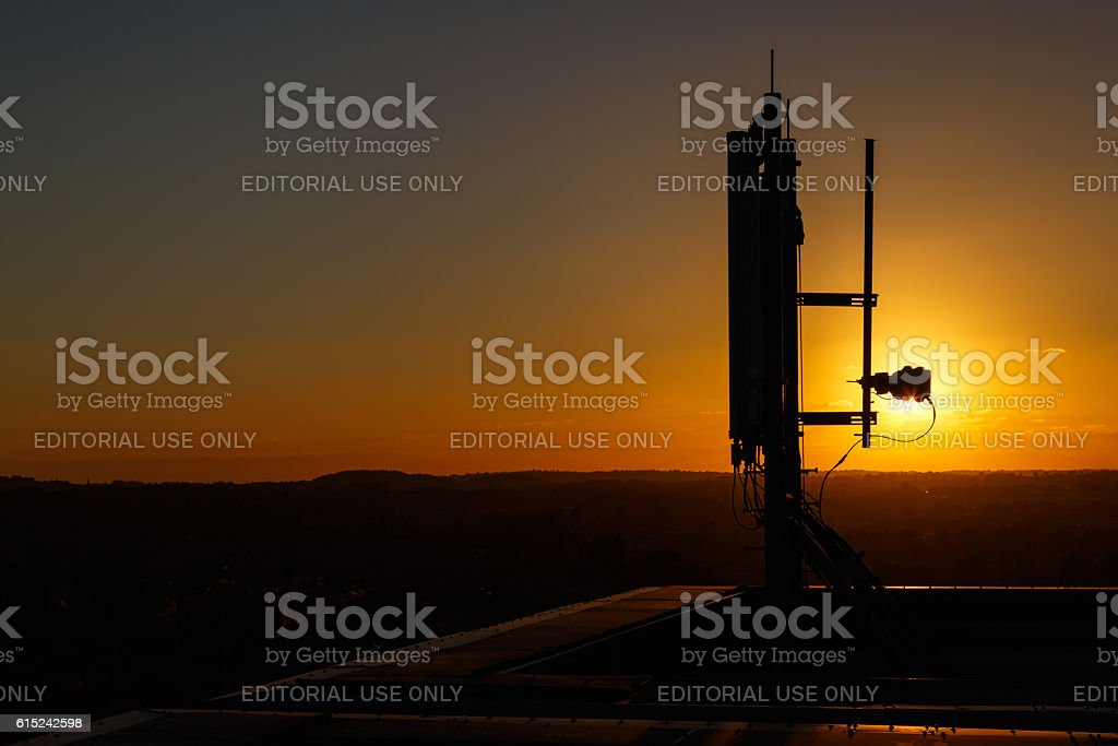 Mobile communications mast/antenna atop a tall building stock photo