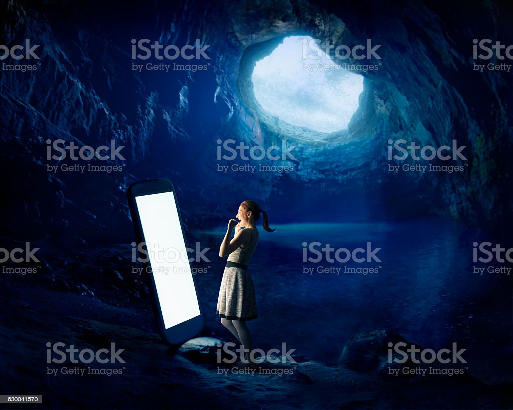 Mobile connection in cave stock photo
