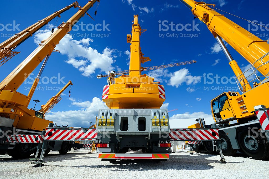 Mobile construction cranes stock photo