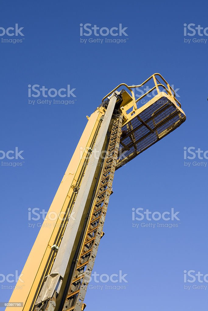 Mobile crane against blue sky royalty-free stock photo
