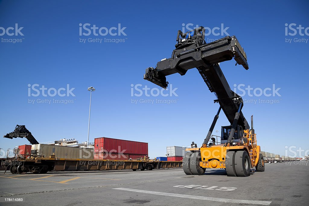 Mobile crane in train rail yard royalty-free stock photo