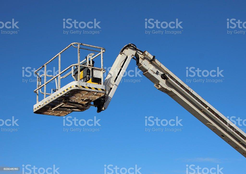 Mobile Crane Lift Basket Isolated on Blue Background stock photo