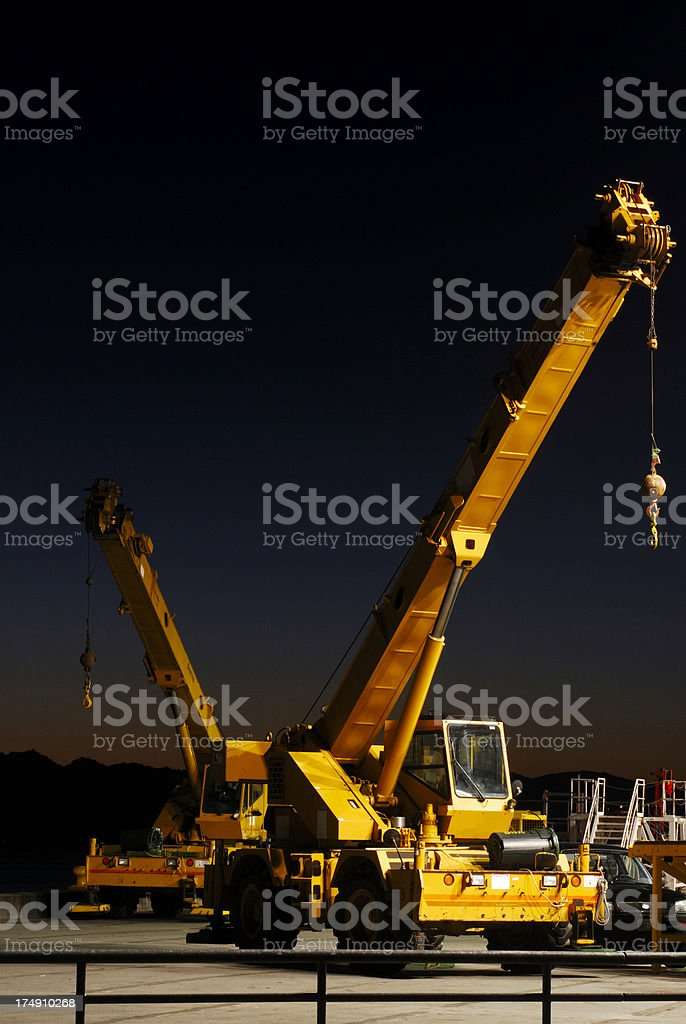 mobile cranes at night stock photo