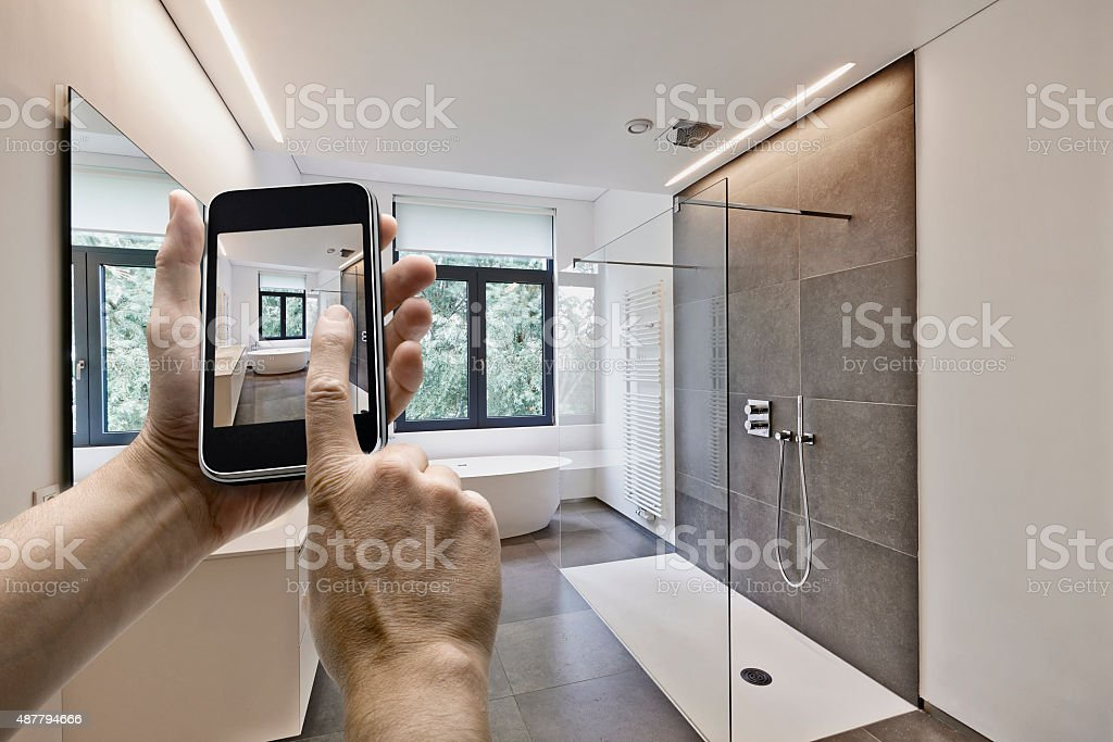Mobile device with man hands taking picture stock photo