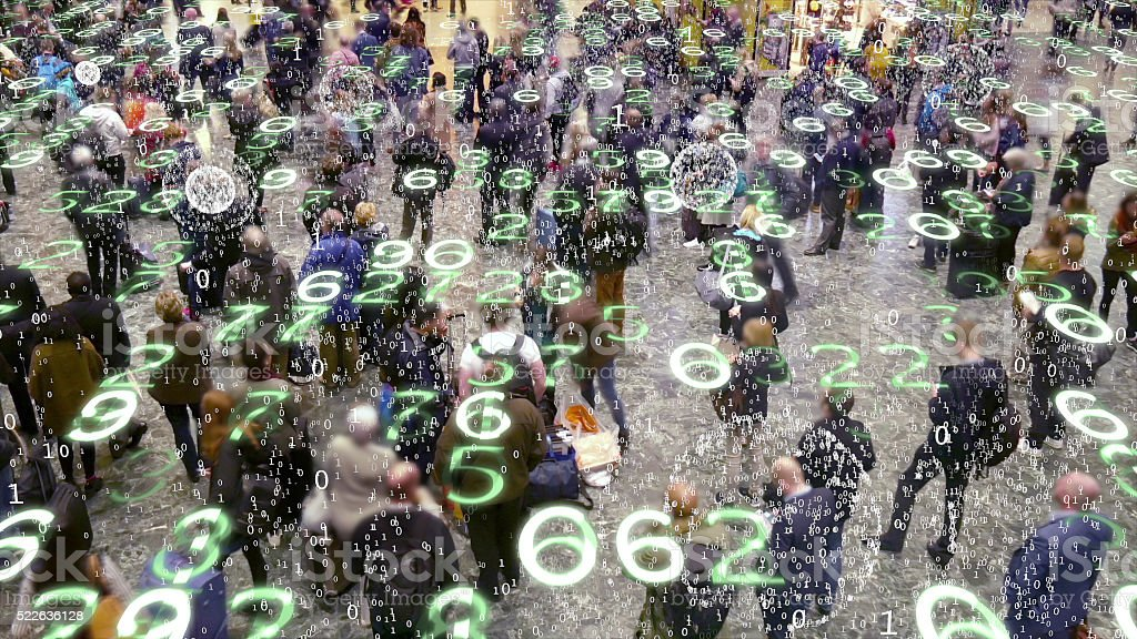 Mobile devices emitting data in a crowd of people. stock photo