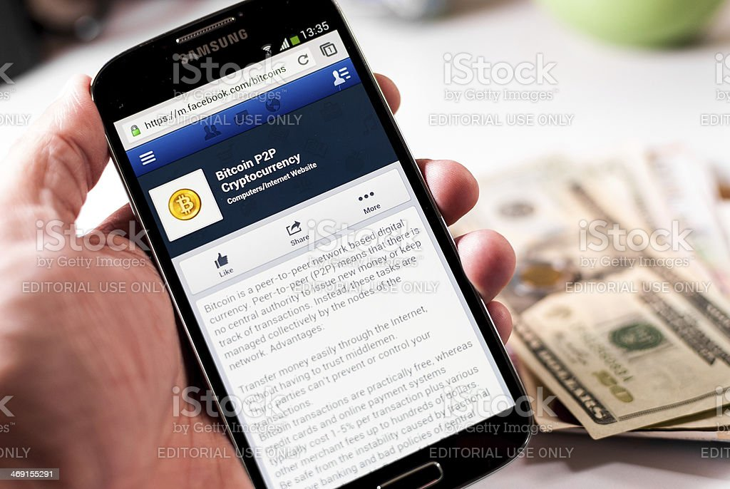 Mobile Facebook page of Bitcoin stock photo