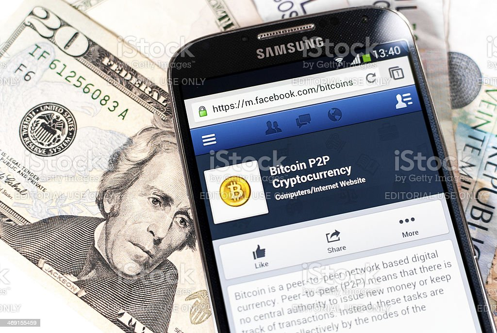Mobile Facebook page of Bitcoin with dollars and pesos stock photo