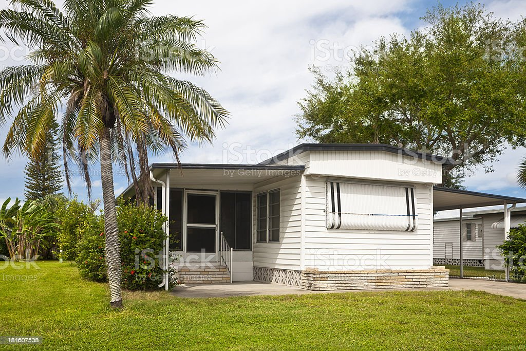 Mobile Home with Palm Tree stock photo