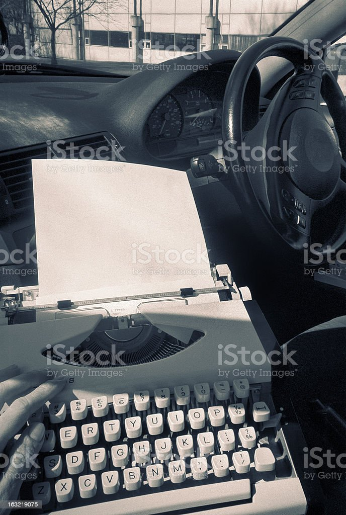 Mobile office: typewriting in the car stock photo