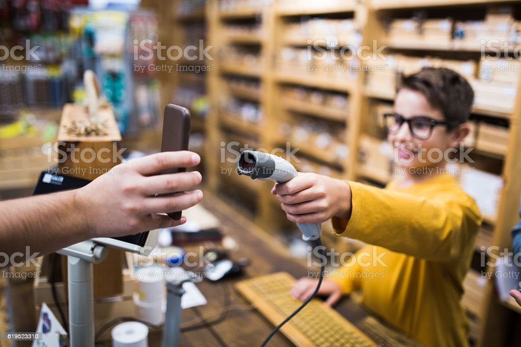 Mobile payment in store stock photo
