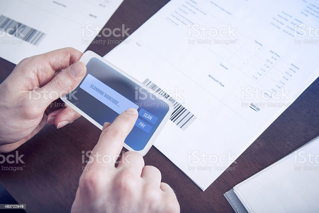 Mobile payment paying bills with phone stock photo