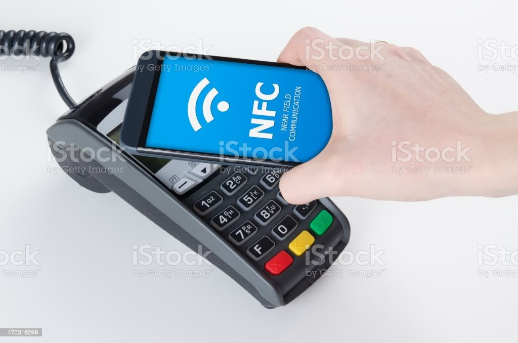 Mobile payment with NFC near field communication technology stock photo