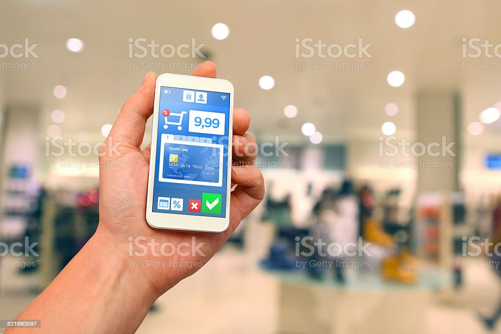 Mobile payment with smartphone at retail store stock photo