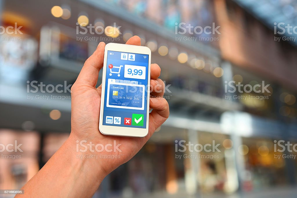 Mobile payment with smartphone at shopping center stock photo