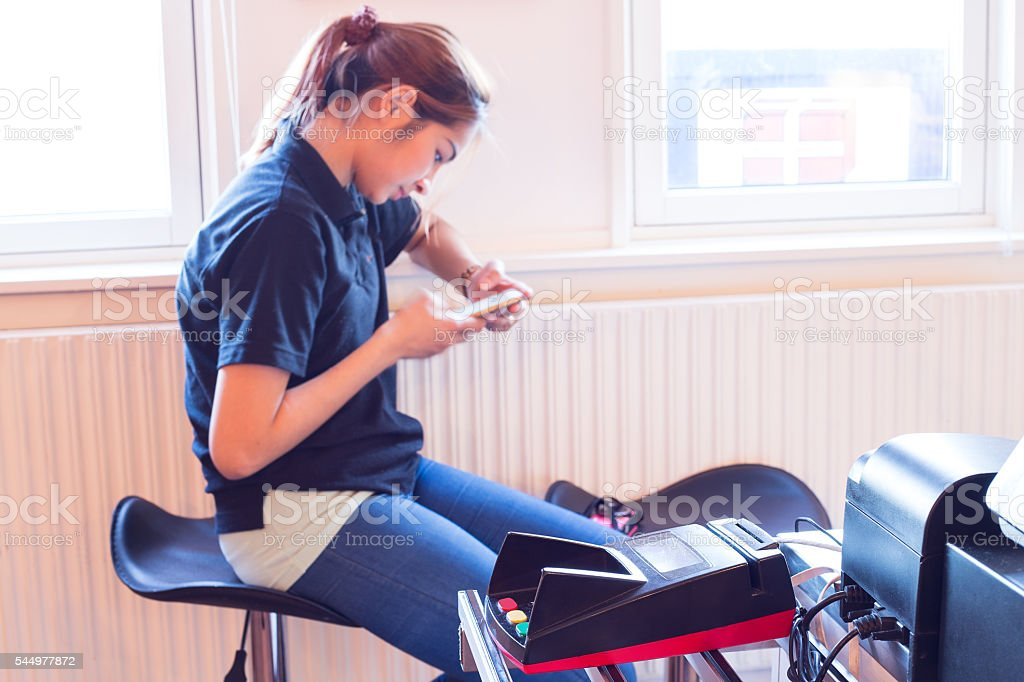 Mobile payment.Women use mobile to pay for goods. stock photo