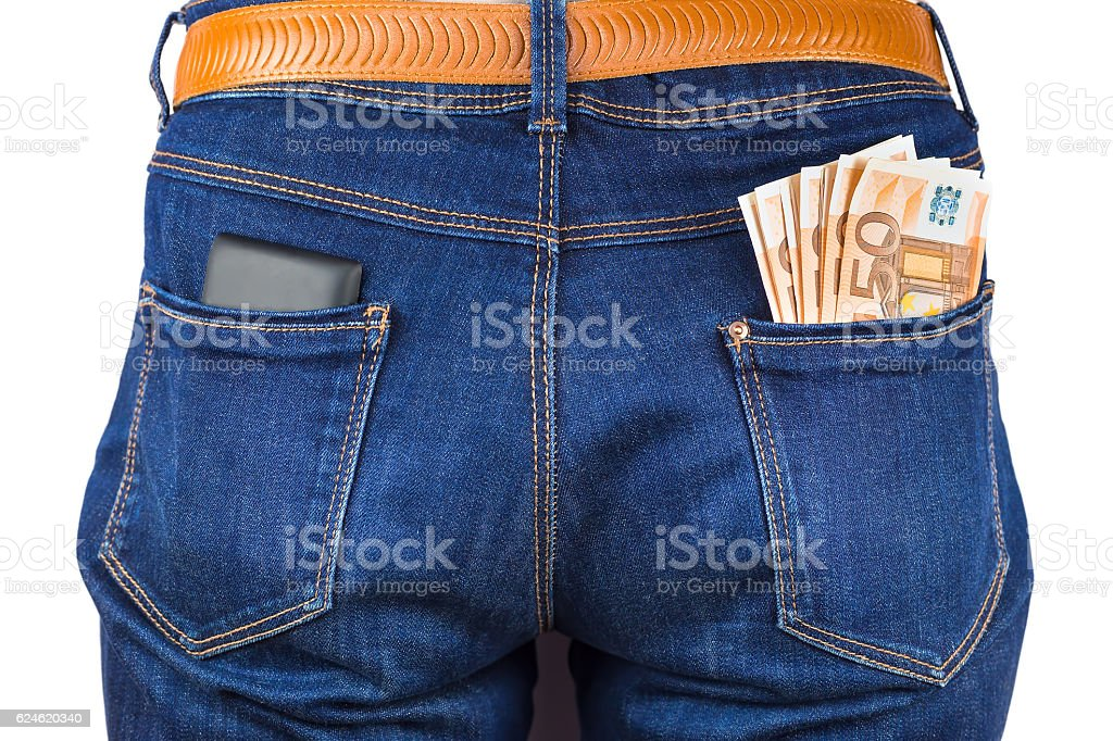 Mobile phone and euro money in blue jeans stock photo