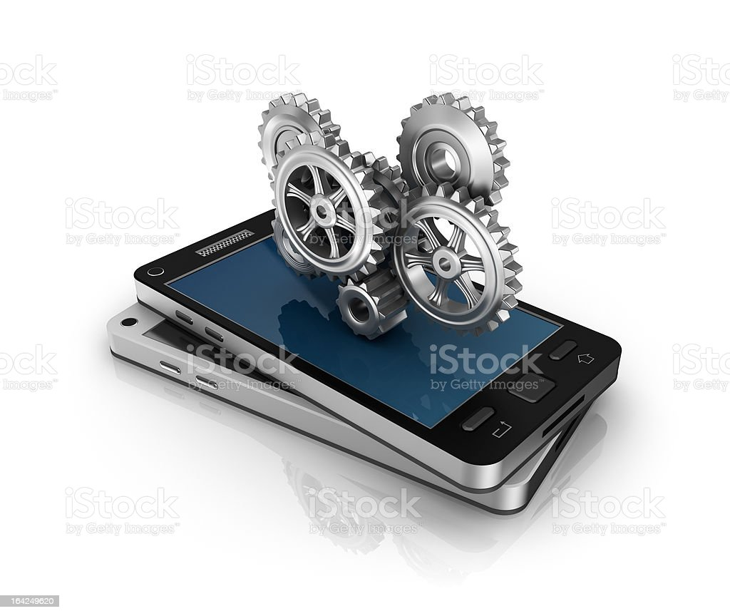 Mobile phone and gears. royalty-free stock photo