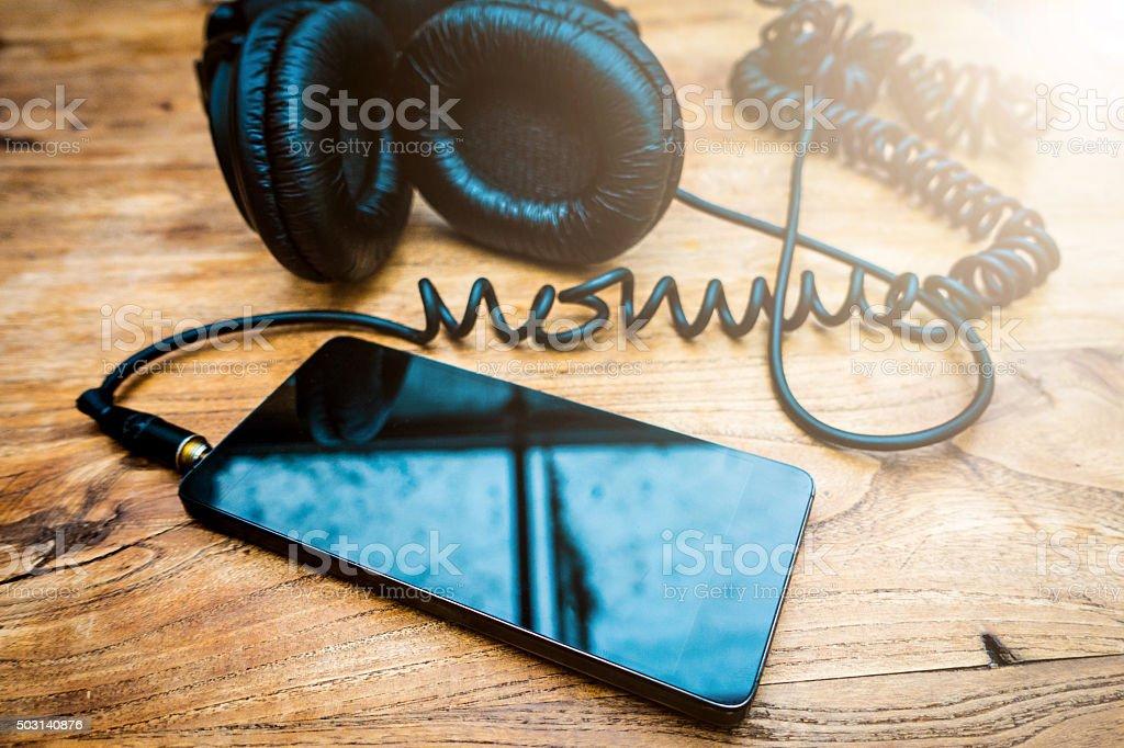 Mobile phone and headphones stock photo