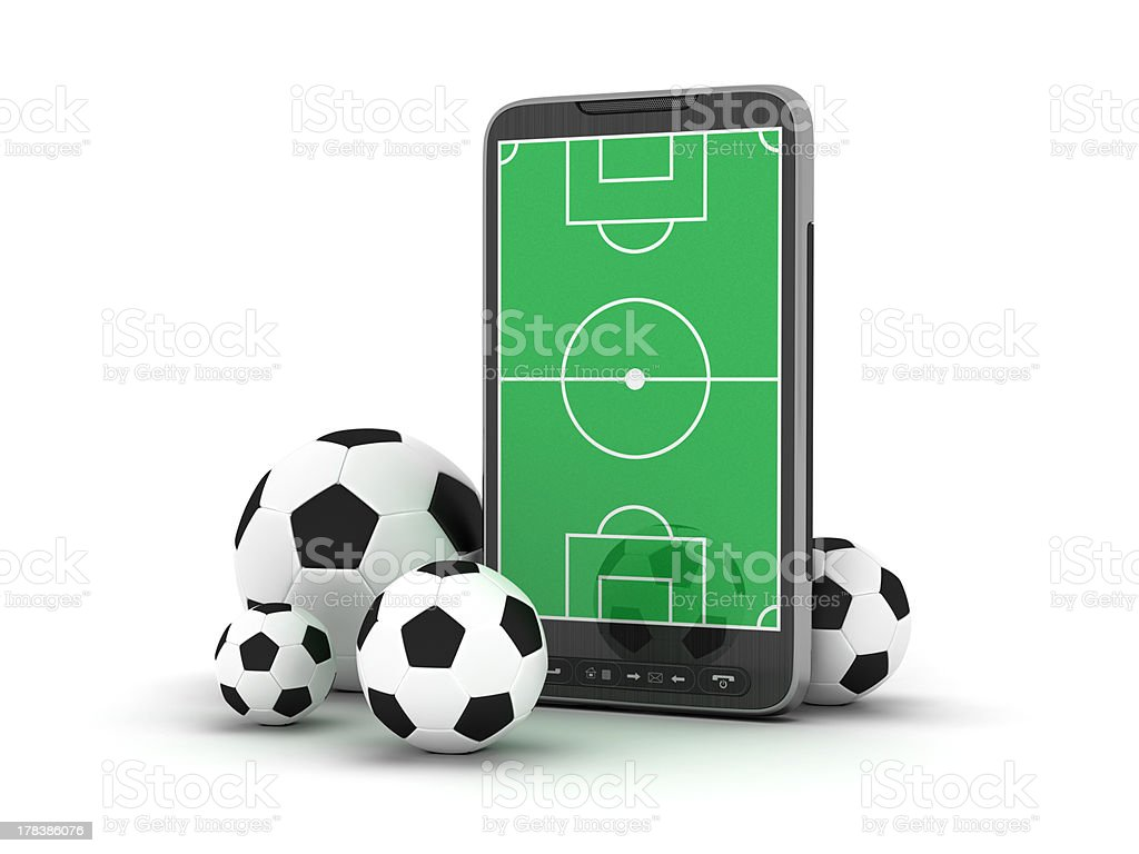 Mobile phone and soccer balls on white background royalty-free stock photo