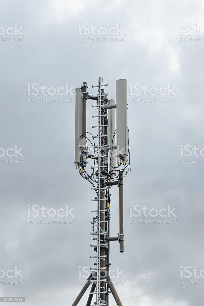 Mobile phone antenna pole stock photo