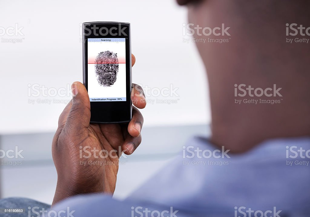Mobile Phone Authentication Using Fingerprint Scan stock photo