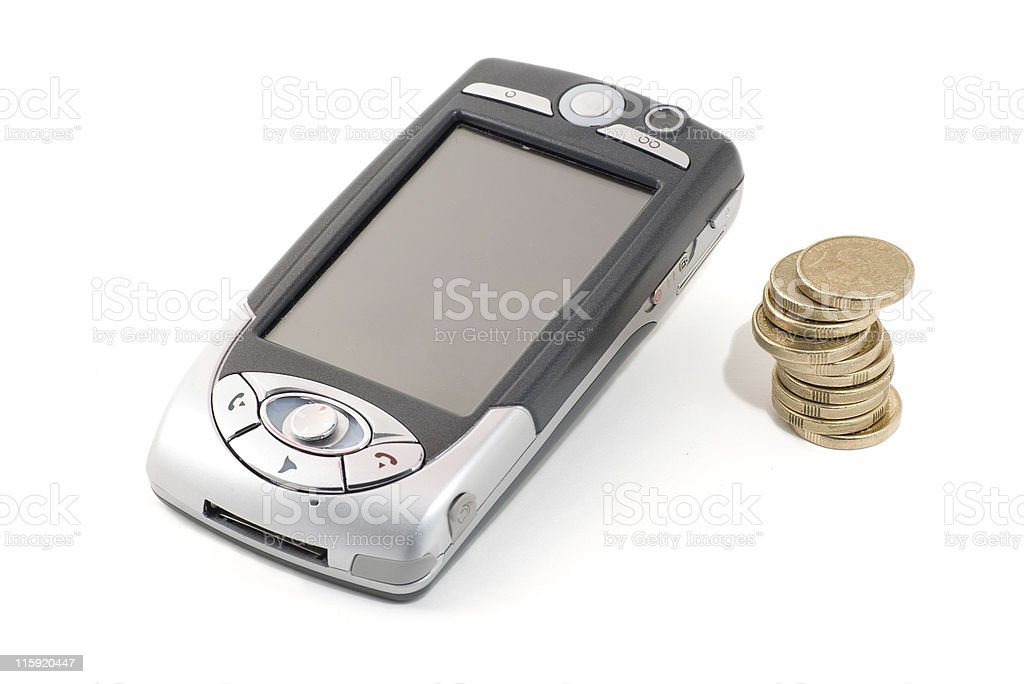 PDA Mobile Phone beside pile of coins, expensive cell calls royalty-free stock photo
