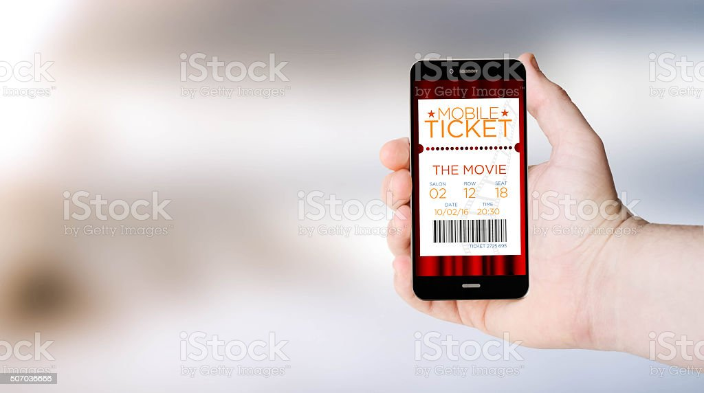 mobile phone cinema tickets shopping on user´s hand stock photo
