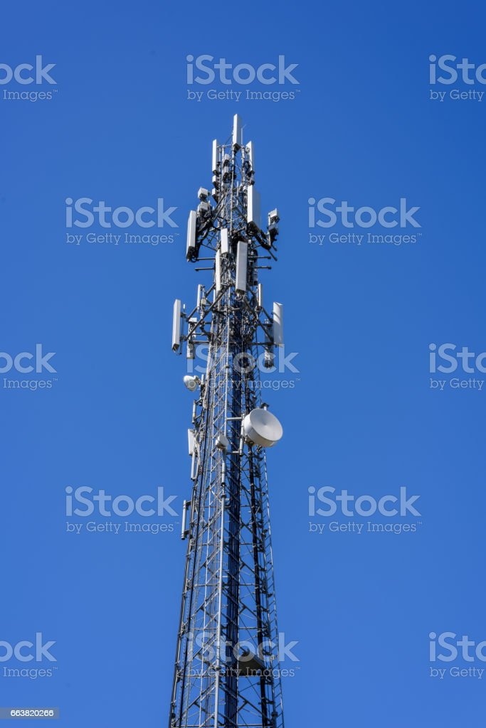 mobile phone communication repeater antenna. cell tower. on the blue sky background. stock photo