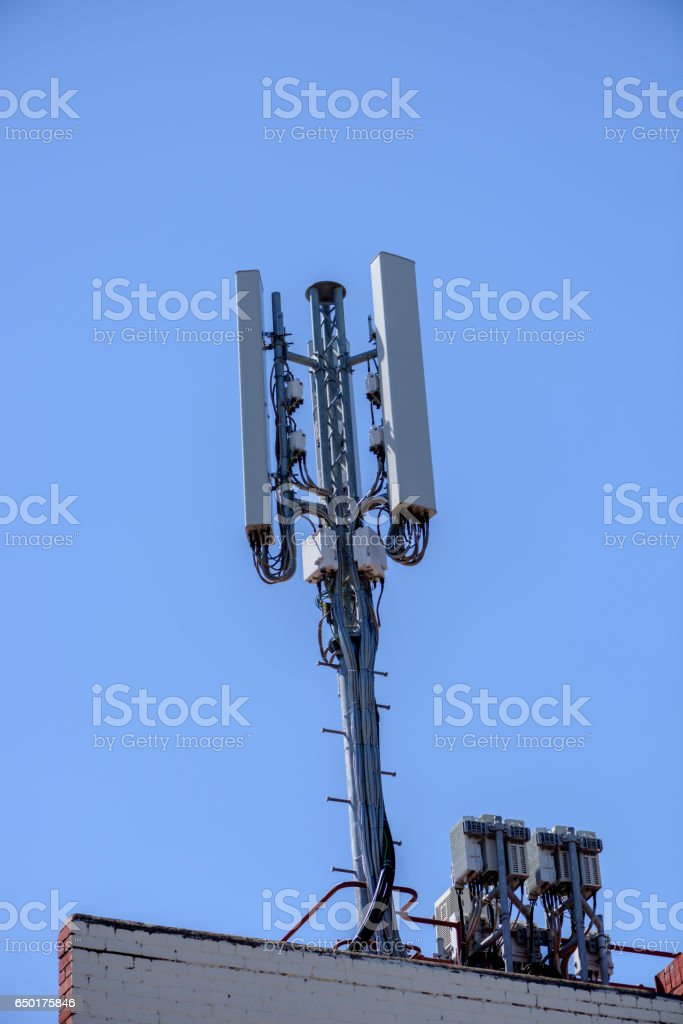 mobile phone communication repeater antenna. stock photo