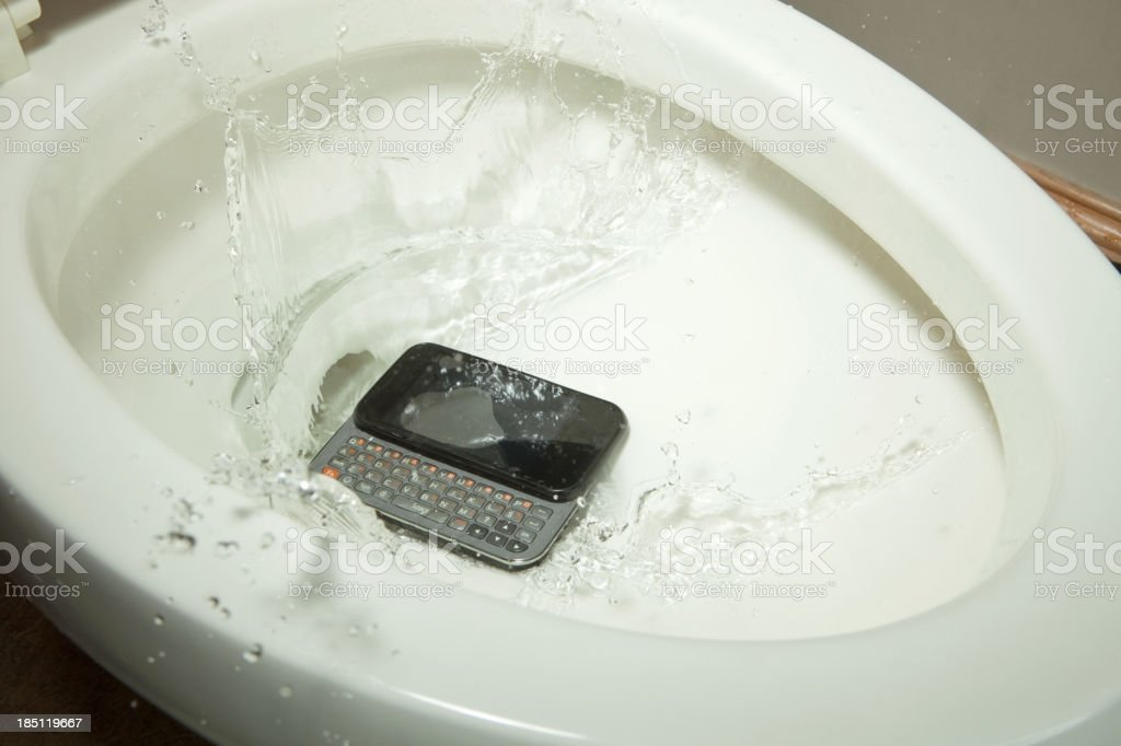 Mobile Phone Drops into a Toilet royalty-free stock photo
